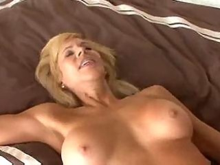 breasty older cougar seduces a younger boy