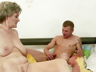breasty grandma enjoys sex with youthful stud