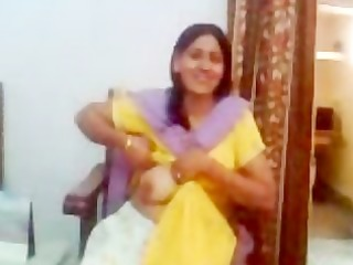 indian aunty showing her milk sacks