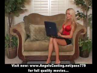 blonde mother i with laptop toying cookie and