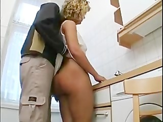 housewife drilled in the kitchen