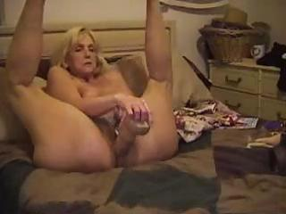 mature blondie sticks a monstrous sex toy and her