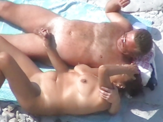 some other worthwhile aged couple on the beach
