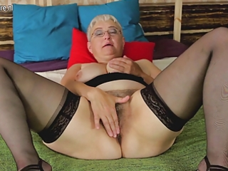 wicked older floozy teasing herself with her toy
