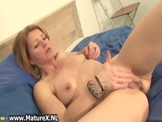 sexually excited housewife rubbing her clitoris