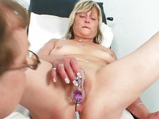 concupiscent golden-haired granny toys her vagina