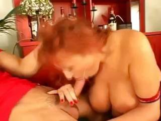 busty mamma takes on two young lads and gives em