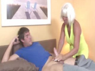 granny welcomes boy wtih a tugjob