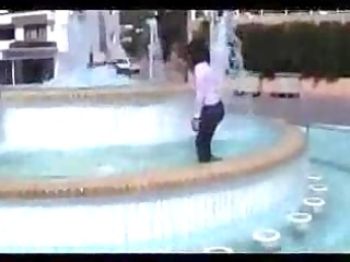 marjorie is getting juicy in a public fountain -