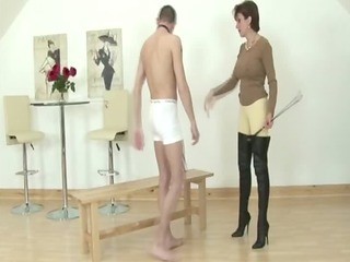 dominatrix takes her seat on his face druing his