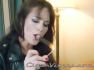 sherry stunns smokes a cigar