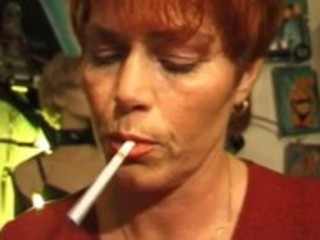 kira red mature german plumper smokes a cigarette