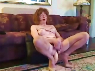 older cd takes a massive dildo in her gazoo