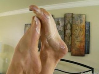 super titted wife gives a astonishing footjob