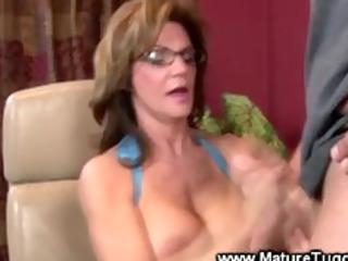 older lady massaging a cock