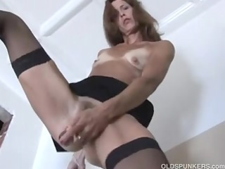 appealing mature red head in stockings