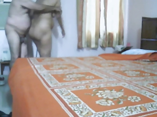 mature indian pair making love in bedroom