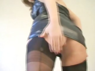 blonde in latex and dark nylons strips and