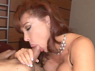 curvy redheaded mamma takes a large one in the
