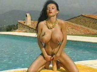 mature chick with huge pierced tits and multiple