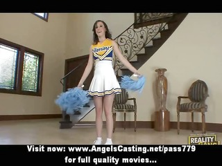 brunette cheerleader flashing pants and doing