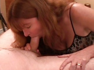 enormous chested redhead milf gives hot blowjob